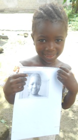 Mariatu holds her picture